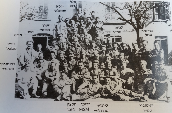 •Menachem Baumgarten and his comrades from the 462 Transport Company. Baumgarten is the crouching figure on the far left. From the book, The Hebrew Transport Company in World War II. Tel Aviv, 1994