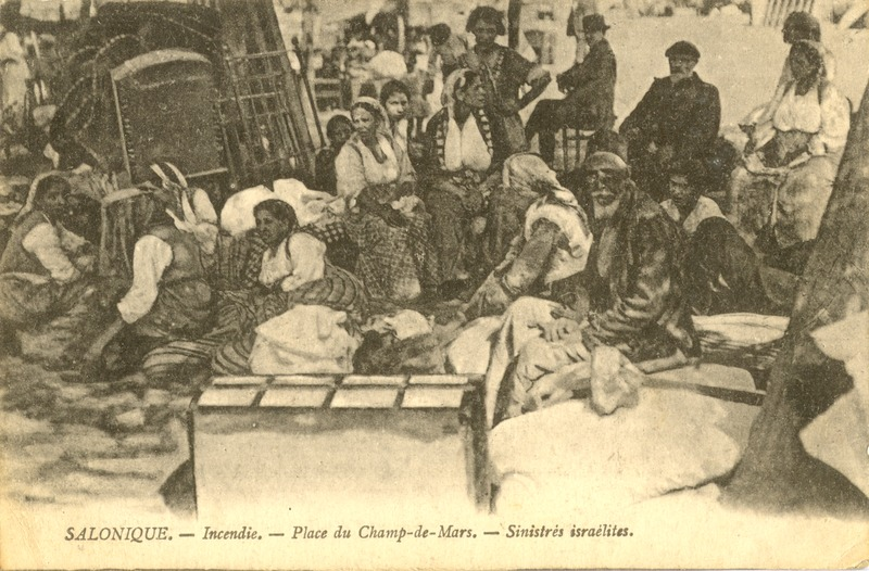 A group of Jews from Salonika left homeless by the fire are seen sitting in the streets with their few remaining belongings. Photograph from the Folklore Research Center, Hebrew University of Jerusalem.