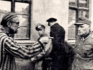 A liberated Russian survivor identifies a Nazi guard, who had participated in the beating of prisoners at Buchenwald.