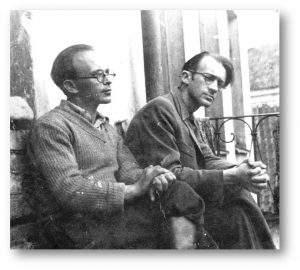 Avraham Sutzkever (right) and Shmerke Kaczerginski in the Vilna Ghetto. Berl Kacherginsky photographed the two friends on the balcony of their apartment on Strashun Street, on the 20th of July, 1943. They look as if they were just a group of friends, not inmates of the Ghetto, starving laborers under a cruel regime, condemned to death. (Photo: Avraham Sutzkever Archive, the National Library of Israel)