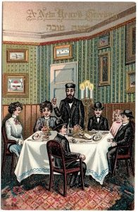 A Jewish family prepares to eat Shabbat dinner, this is perhaps the most common theme featured in postcards of this type. Unknown artist, the National Library Ephemera Collection.
