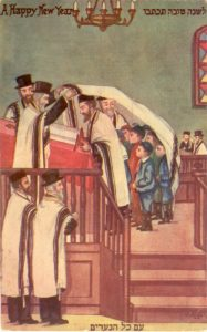 "This postcard depicts the Simchat Torah holiday custom of ""Kol HaNearim"" (all the boys), in which the young boys of the congregation are called to gather under a large talit as Genesis 48:16 is recited - a verse from Jacob's blessing to Ephraim and Manashe. By artist Jacob Keller circa 1910, the Hebrew Publishing Company, the National Library Ephemera Collection."