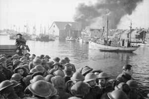 Fires burning in Stamsund, Lofoten, Norway as British commandos leave. Photo by Capt. Tennyson d'Eyncourt, British War Office official photographer