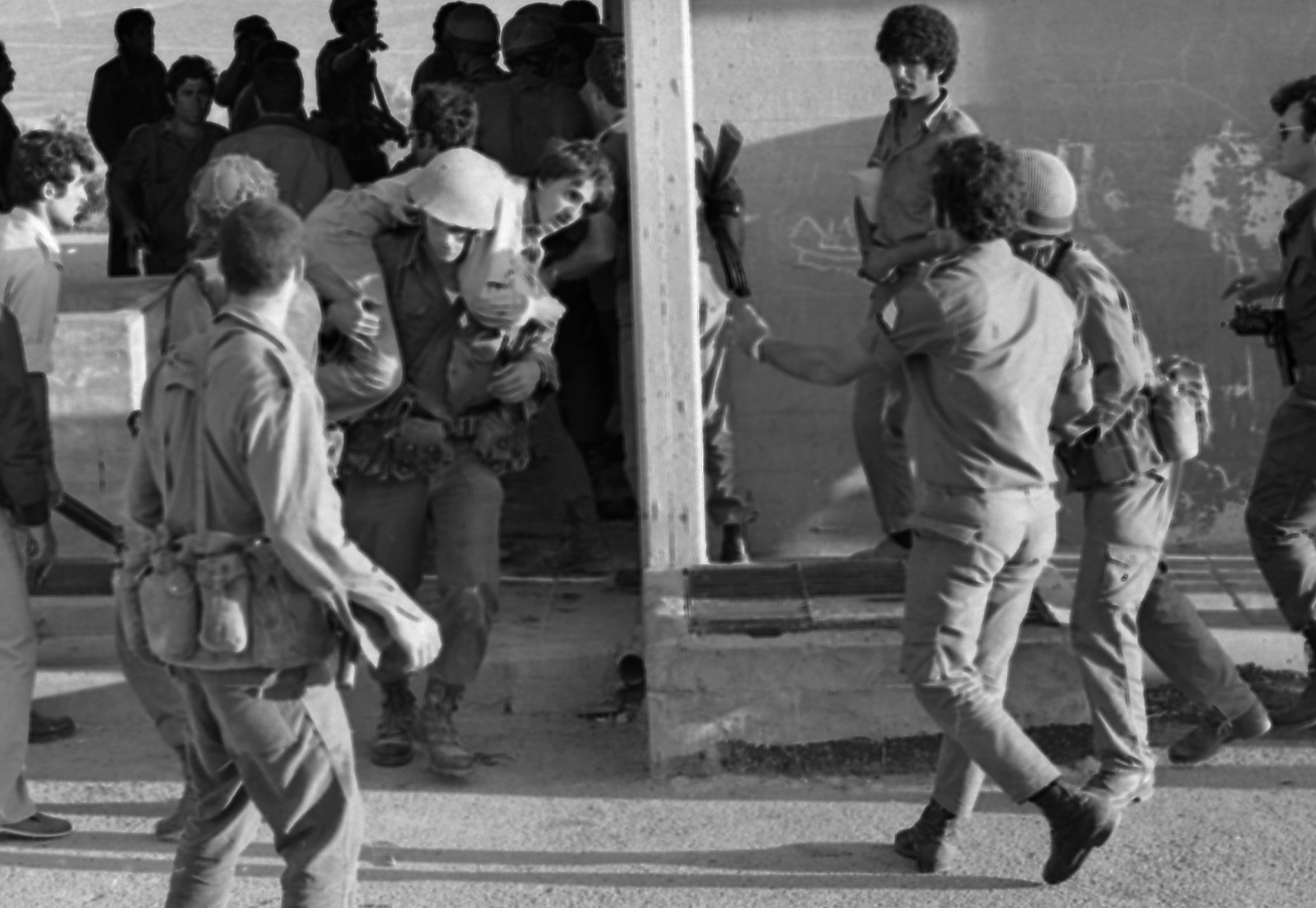 An Arab terrorist group attacked a school at Maalot killing several children and wounded thenth of them. IDF attacked the group killing the terrorists. Photo shows: Soldier rescue the wounded children from the school 1974/05/15 Copyright © IPPA 09239-004-14 Photo by IPPA Staff