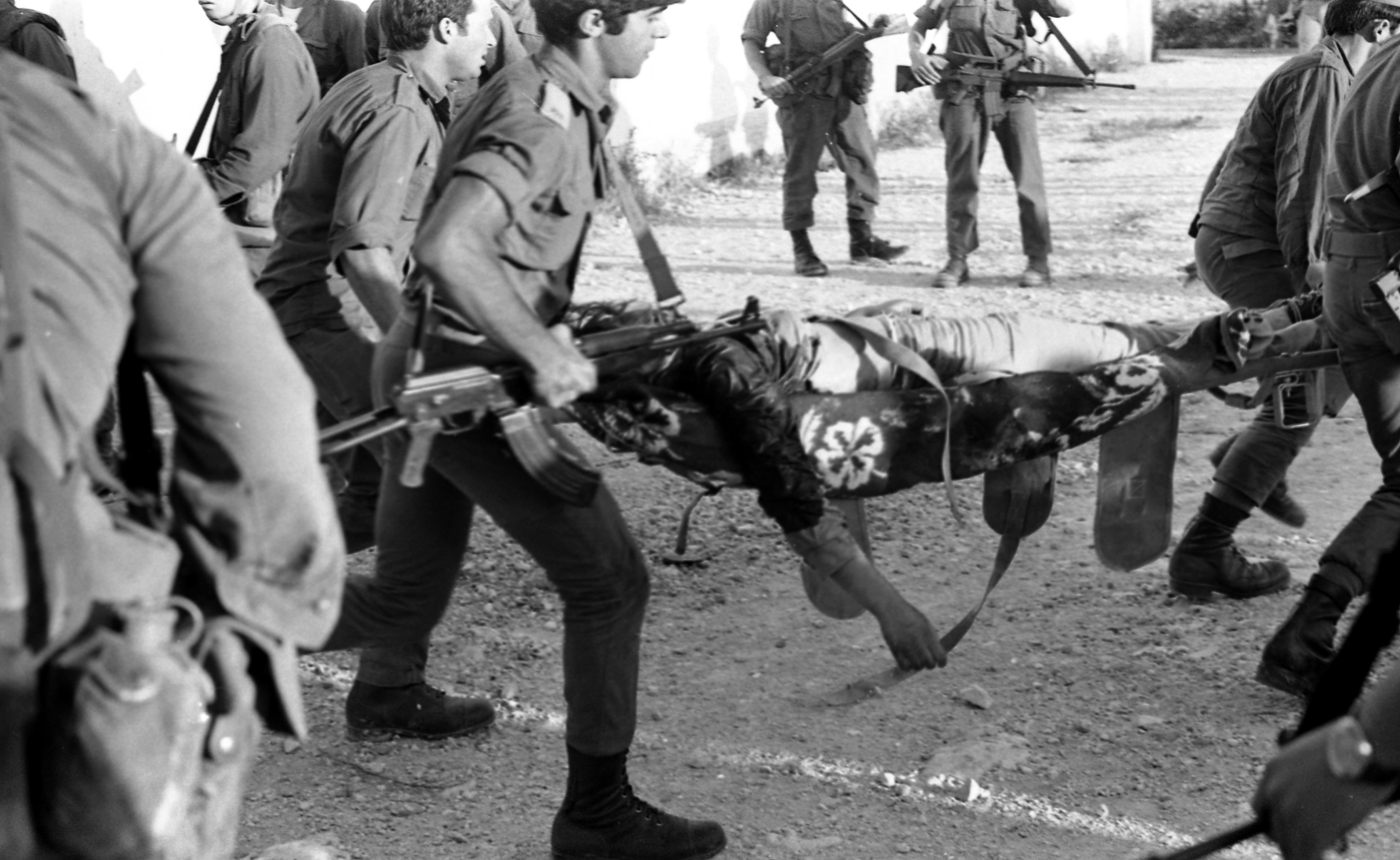 An Arab terrorist group attacked a school at Maalot killing several children and wounded thenth of them. IDF attacked the group killing the terrorists. Photo shows: Soldier rescue the wounded children from the school 1974/05/15 Copyright © IPPA 09239-004-26 Photo by IPPA Staff