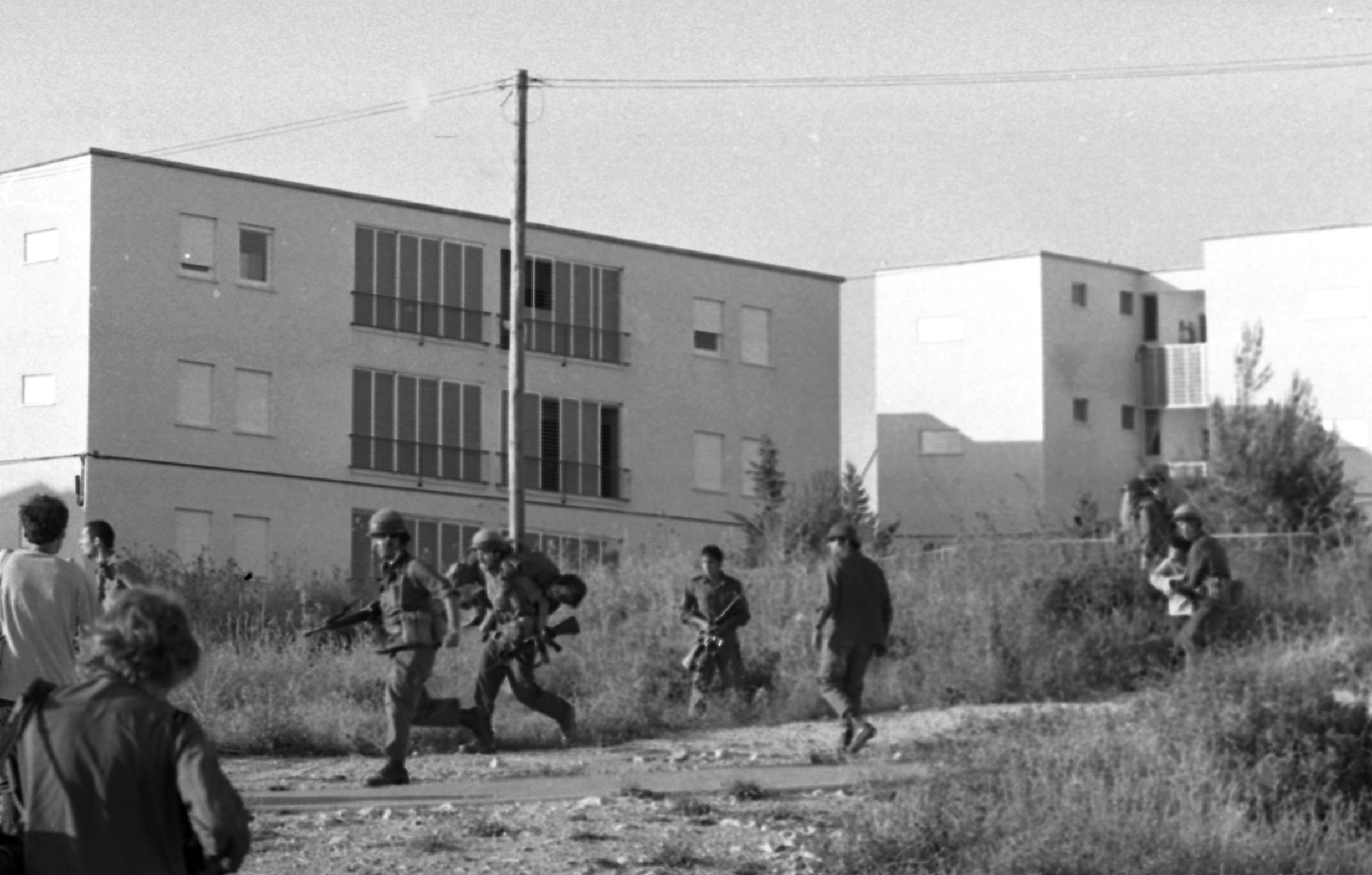 An Arab terrorist group attacked a school at Maalot killing several children and wounded thenth of them. IDF attacked the group killing the terrorists. Photo shows: Soldier rescue wounded children from the school 1974/05/15 Copyright © IPPA 09239-007-41 Photo by IPPA Staff