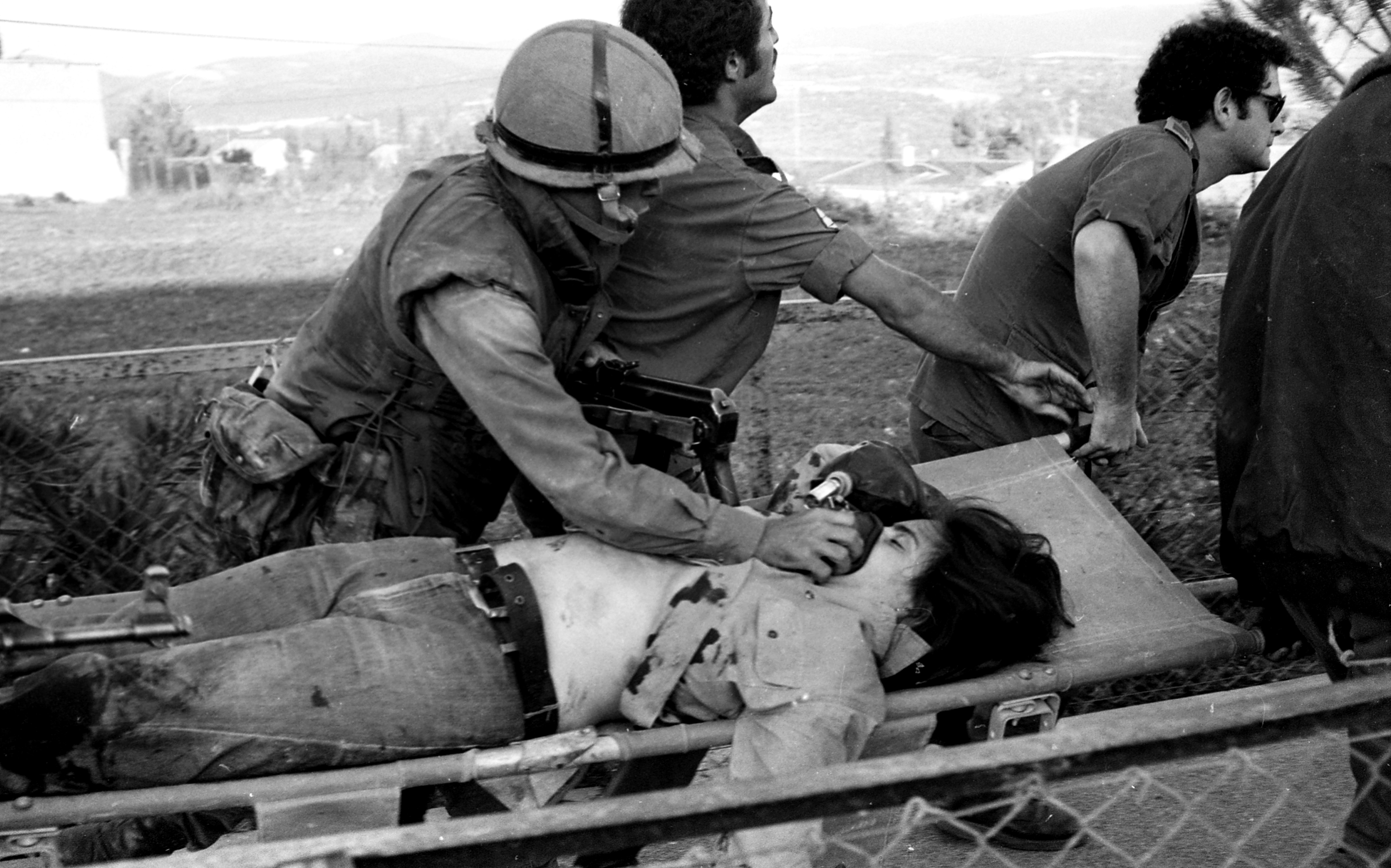 An Arab terrorist group attacked a school at Maalot killing several children and wounded thenth of them. IDF attacked the group killing the terrorists. Photo shows: IDF carrying wounded children 1974/05/15 Copyright © IPPA 09239-010-42 Photo by IPPA Staff