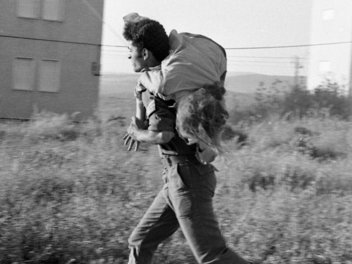 An Arab terrorist group attacked a school at Maalot killing several children and wounded tenth of them. IDF attacked the group killing the terrorists. Photo shows IDF carrying a wounded child. 1974/05/15 Copyright © IPPA 09239-011-03 Photo by IPPA Staff