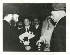 Rabbi Menachem Mendel Schneerson officiating at a kiddushin ceremony, New York, 1951.