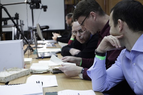 Dr. Stefan Litt of the National Library's Archives Department examines items from the Kafka estate.